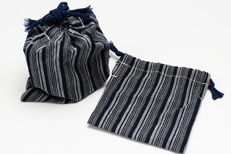「亀田縞」の巾着をセットでお届け!